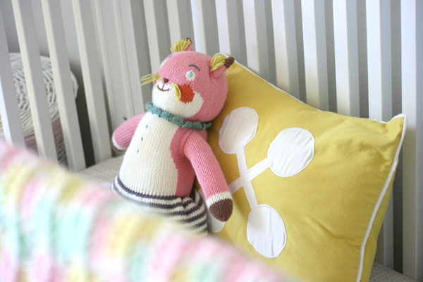 A pink & yellow safari: crib detail