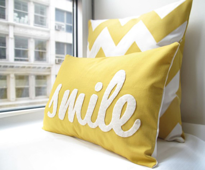 Etsy purchase: smile pillow in yellow by Honey Pie Design