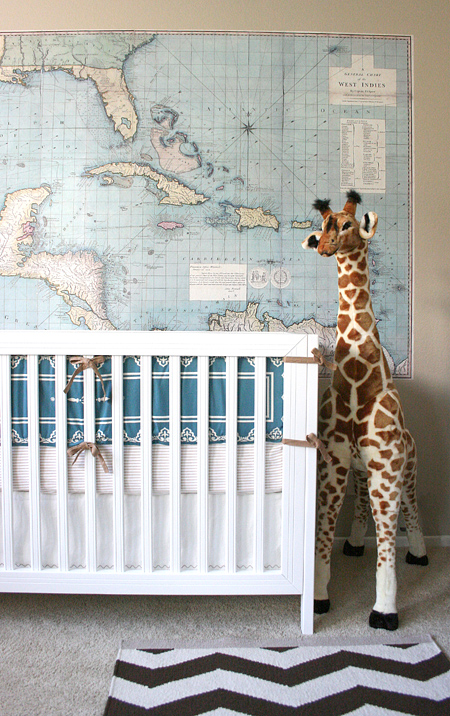 Jackson's nursery: crib, map, giraffe
