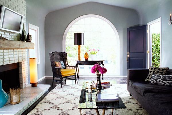 Kishani Perera living room, moroccan rug, white brick fireplace, ikat, black, gold