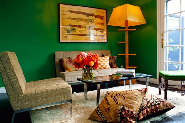 Kishani Perera sitting room, green walls, flokati rug, kilim pillows