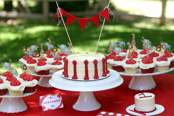 vintage circus birthday party: cake, garland, cupcakes, animal toppers, red, white