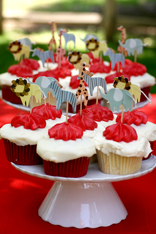 vintage circus birthday party: cupcakes, animal toppers, red, white
