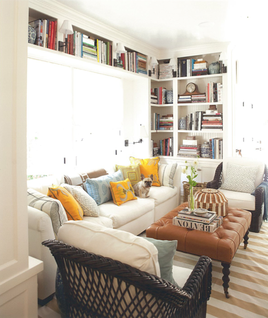 external image mark-d-sikes-family-room-rattan-chairs-leather-ottoman-bookshelves-house-beautiful.png