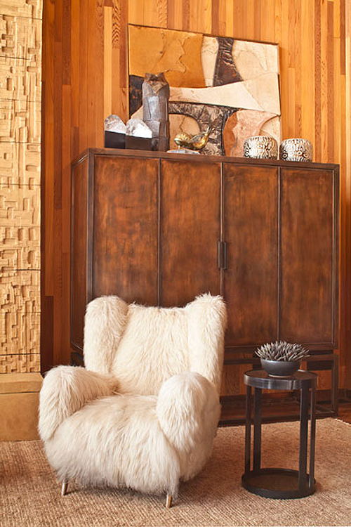 Kelly Wearstler beach house living room wood paneling fur covered chair