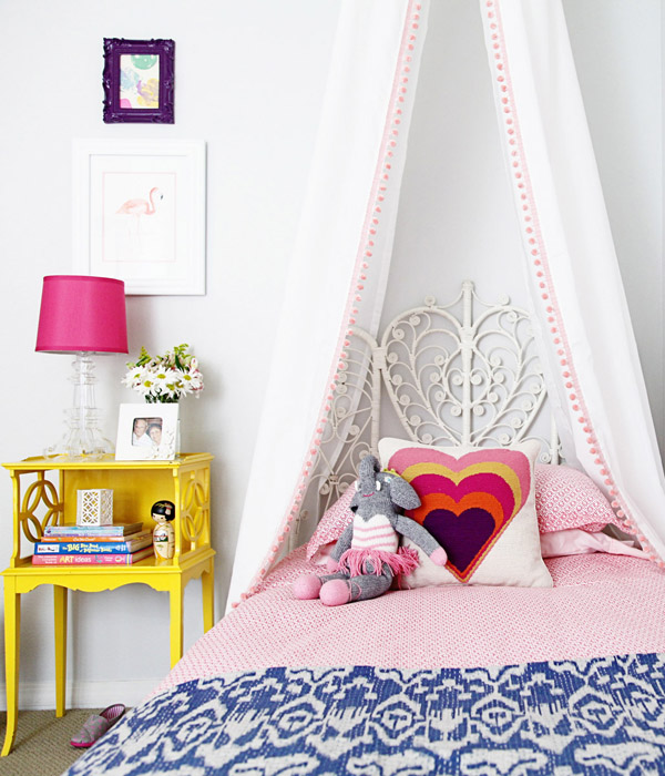 small-shop-big-girl-room-cute-bohemian-bed-DIY-canopy-vintage-peacock-headboard-John-Robshaw-Jonathan-Adler-kantha-ikat-quilt-vintage-yellow-nightstand