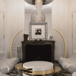 Lenny-Kravitz-Paris-apt-living-room-white-glam-fur-chandelier-1970s-brass-table-fireplace-tusks