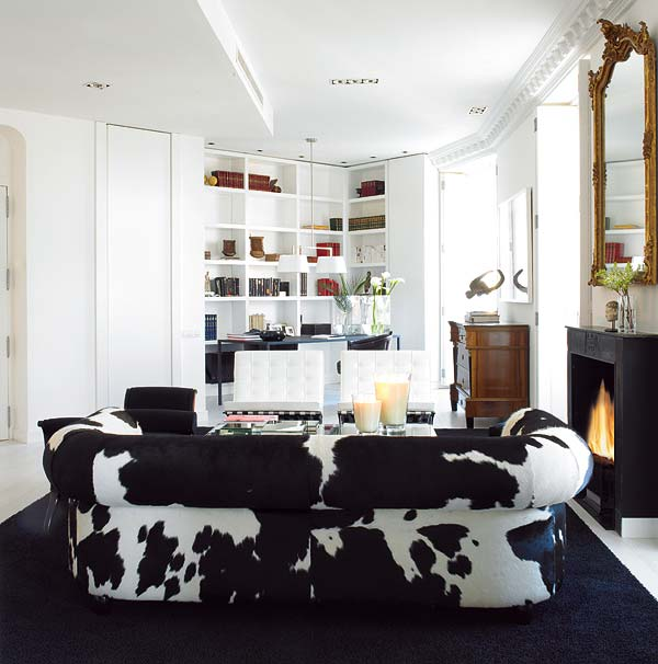 Carlos-Serra-Valencia-home-black-white-living-room-cowhide-couch-Barcelona-chairs-bookshelves