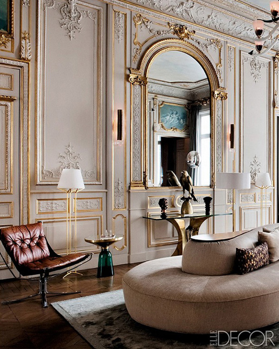 glam-grand-salon-Paris-apartment-gold-molding-gray-paneling-modern-furnishings
