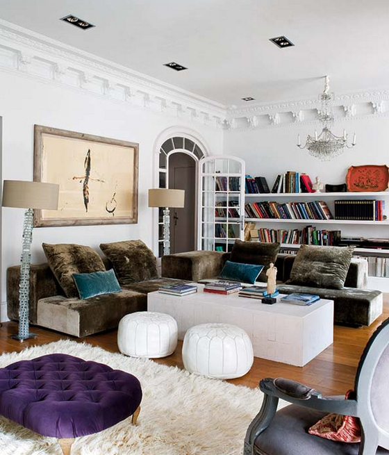 Ana-Ros-living-room-traditional-1970s-mix-chandelier-bookshelves-shaggy-rug-velvet-couch-poufs-purple-ottoman