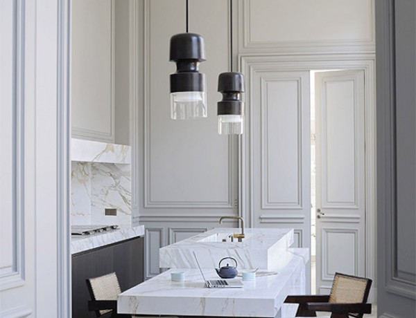 Joseph-Dirand-Paris-luxe-minimal-kitchen-white-marble-gray-molding-Pierre-Jeanneret-chairs-bronze-pendants