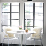 small shop Erika Brechtel breakfast nook black pendant white tulip table acrylic chairs fur