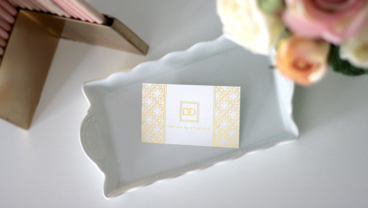 Design by Occasion gold foil biz card by Erika Brechtel