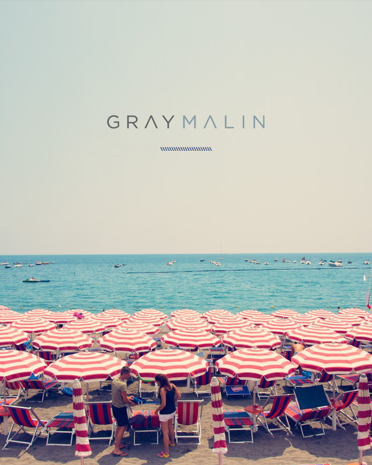Gray Malin logo by Erika Brechtel Minori red white umbrellas