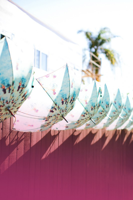 Gray Malin Aqua Glam launch party entrance umbrellas photo by Paige Jones