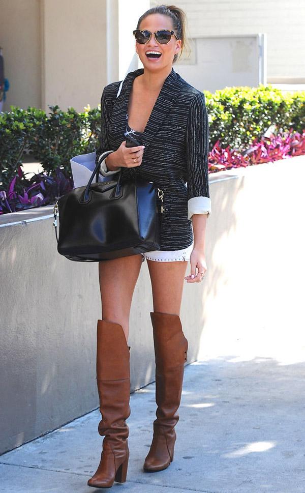 chrissy-teigen-street-style-black-blazer-studded-shorts-black-tote-knee-high-boots