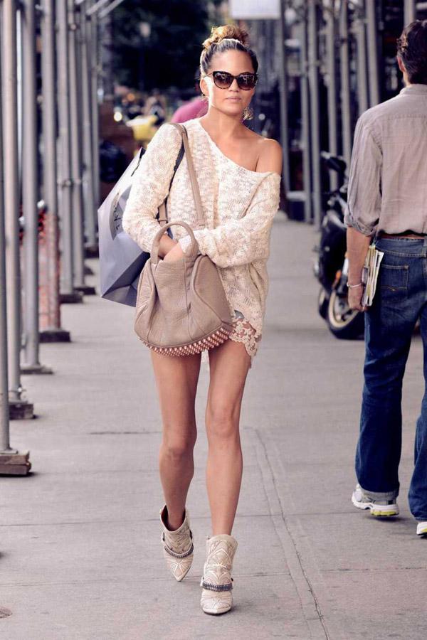 chrissy-teigen-street-style-isabel-marant-booties-alexander-wang-rocco-sweater-denim-cutoff-shorts