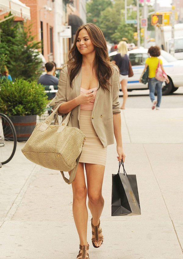 chrissy-teigen-street-style-khaki-skirt-blazer-beach-blouse-raffia-tote-gladiator-sandals