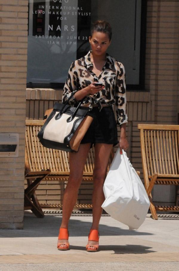 chrissy-teigen-street-style-silk-leopard-blouse-orange-sandals-celine-tote