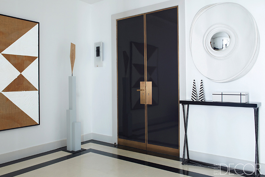 Parisian Apt by Champeau Wilde entry white black brass doors console sculpture Mark Hagen painting