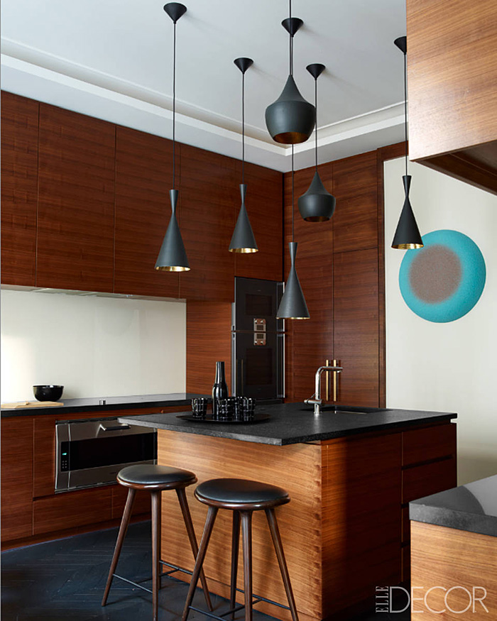 Parisian Apt by Champeau Wilde kitchen walnut veneer cabinetry black granite countertops Tom Dixon pendants