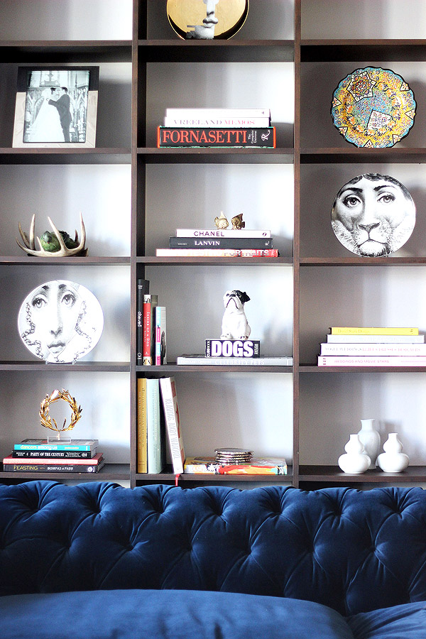 Soho NYC loft Tamra Sanford bookshelves blue velvet tufted sofa