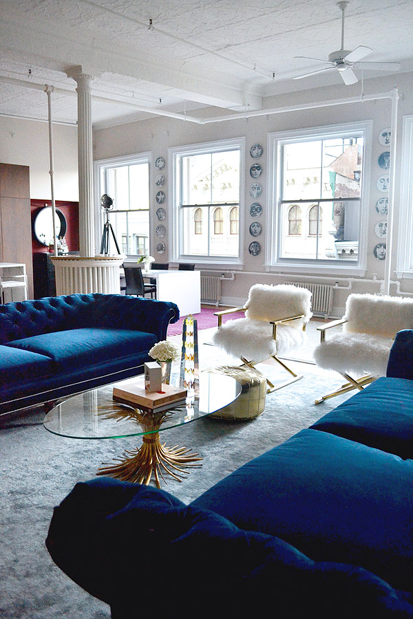 Soho NYC Loft Tamra Sanford Living Room Fuzzy Chairs Blue Velvet Sofas  Windows
