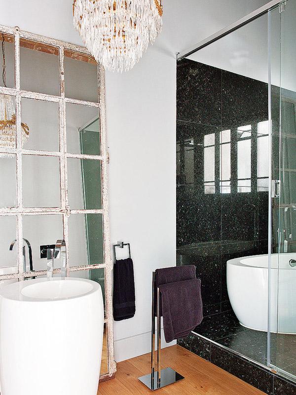 colorful classic Barcelona bathroom black granite shower chandelier modern sink paned standing mirror