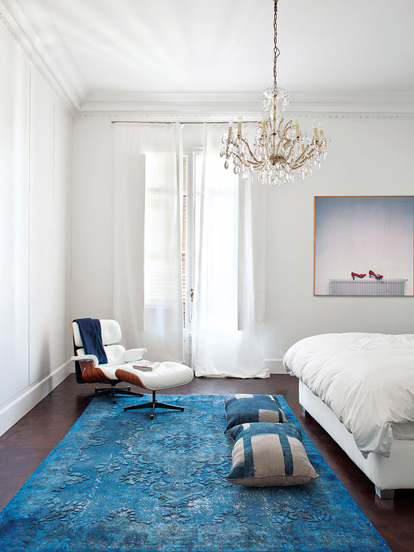 colorful classic Barcelona bedroom blue rug Eames lounge chair chandelier white contemporary photography art