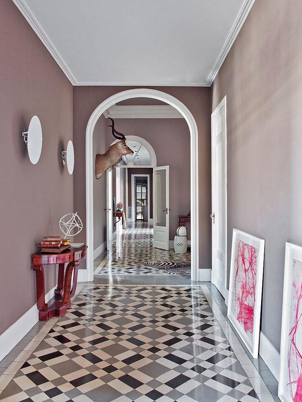 colorful classic Barcelona hallway tiled floor gray walls horns modern art