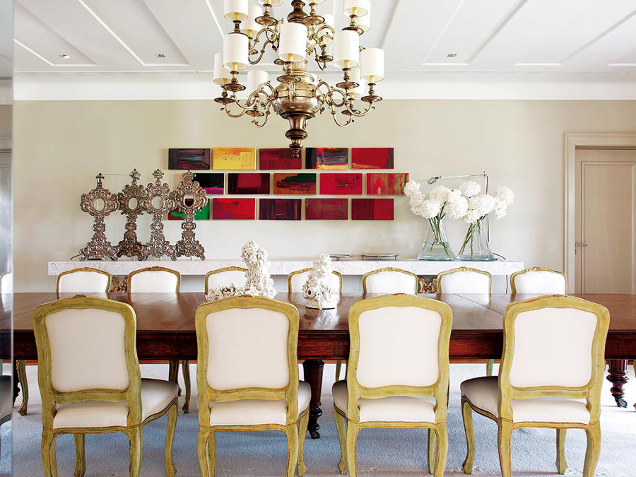contemporary glam in Portugal dining room antique chandelier French cabriole leg chairs