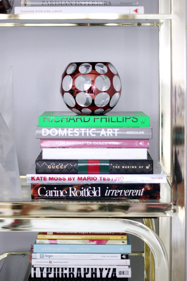 Erika Brechtel brass etagere design books library stack