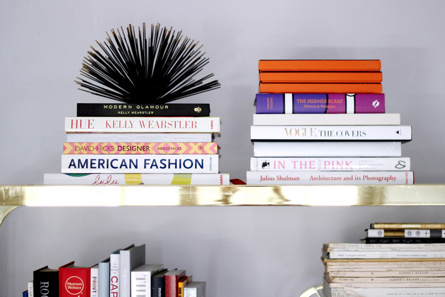 Erika Brechtel brass etagere design books library stacked books toppers Hermes boxes