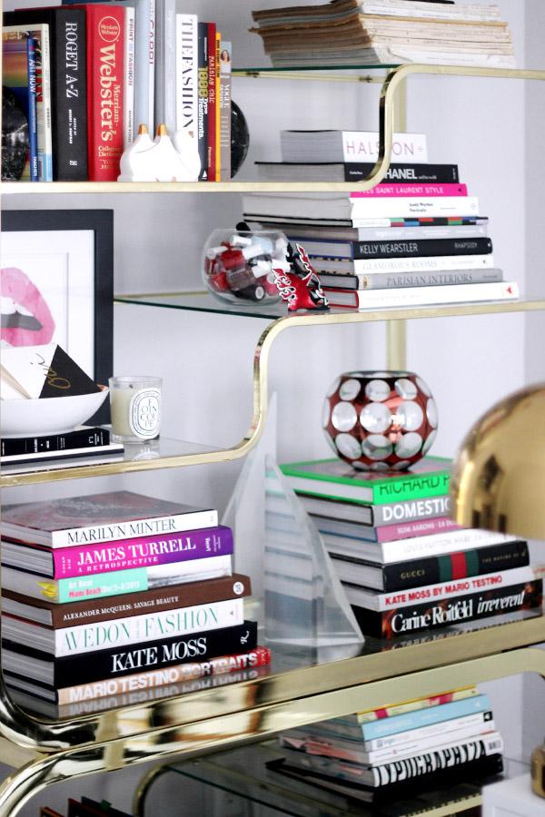 Erika Brechtel brass etagere design books library vignette