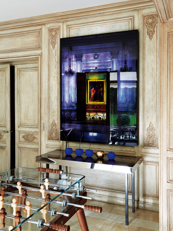 Epic Paris pop art apt living room traditional wall paneling Winnie Denker photograph foosball table