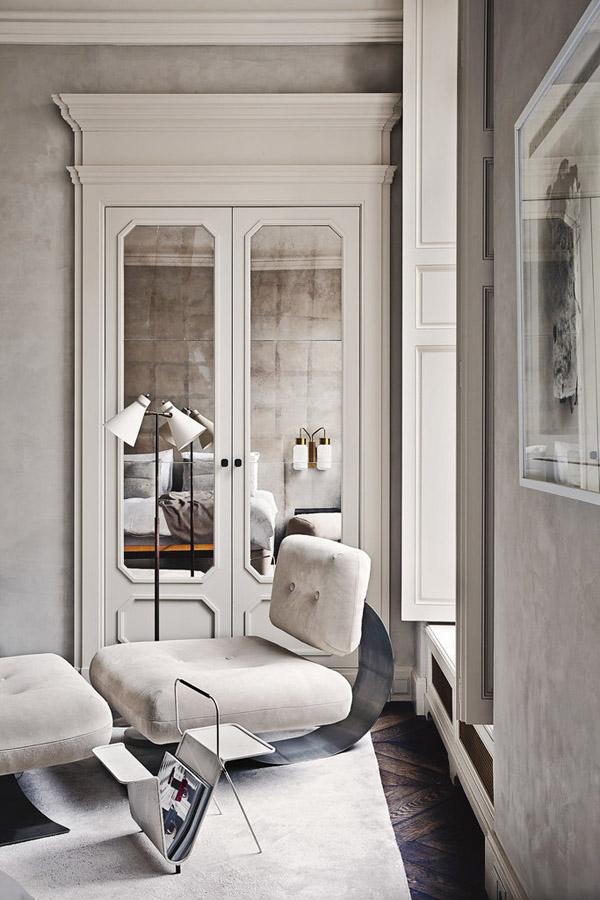 Joseph Dirand Parisian minimalist apt gray bedroom lounge chair window