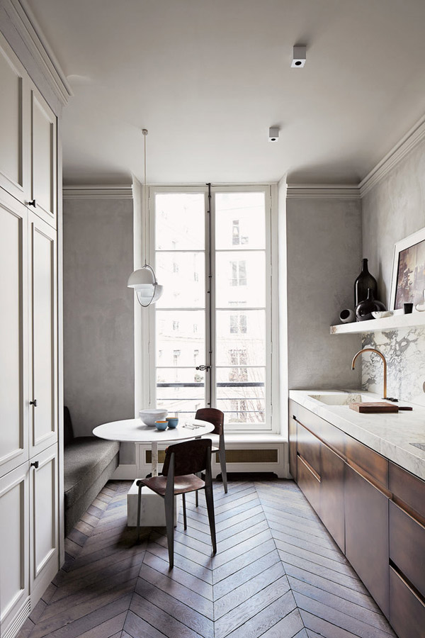 Joseph Dirand Parisian minimalist apt kitchen eat in herringbone wood floors