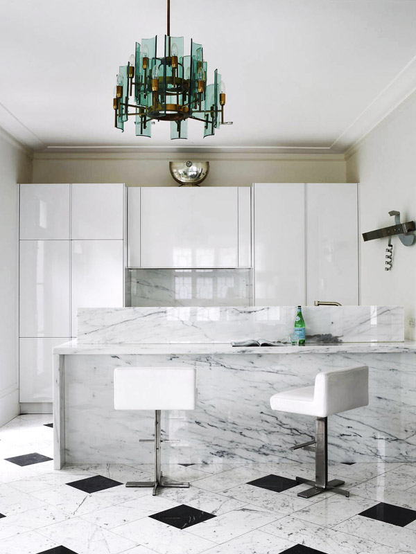 London townhome Colin Radcliffe kitchen white marble waterfall island white cabinets