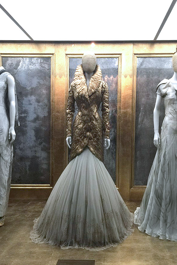 Alexander McQueen Savage Beauty Victoria and Albert Museum gold feathered jacket tulle skirt
