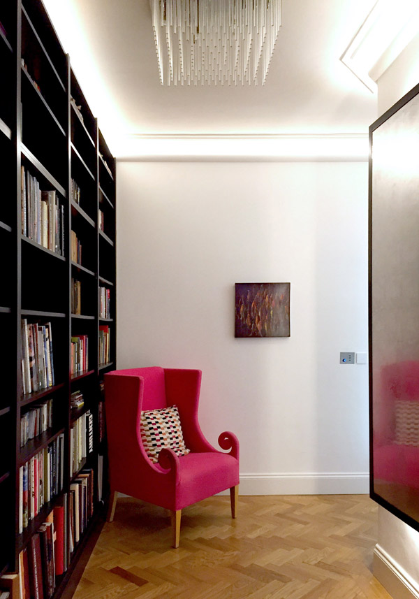 art flat Kensington London Unity Cantwell 12 entry black bookcases pink chair