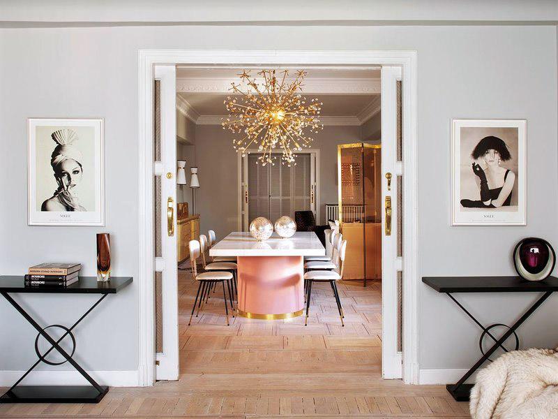 Living Pink Madrid apt vintage femme elegance glam dining room sliding doors Vintage Vogue photographs pink brass table brass flower chandlier