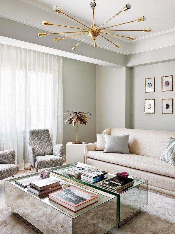 Living Pink Madrid apt vintage femme elegance glam living room neutrals mirrored coffee tables brass sputnik lamp