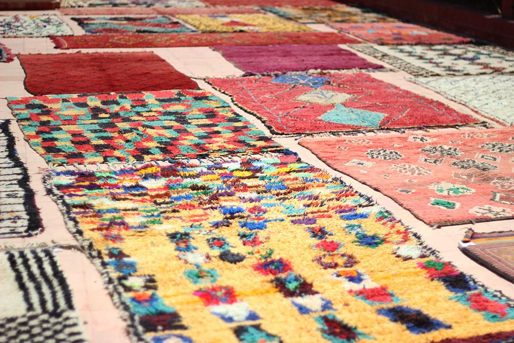 Morocco Marrakech medina rug vendor rooftop Erika Brechtel