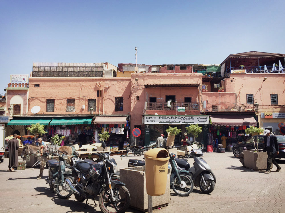 Morocco Marrakech plaza buildings Erika Brechtel