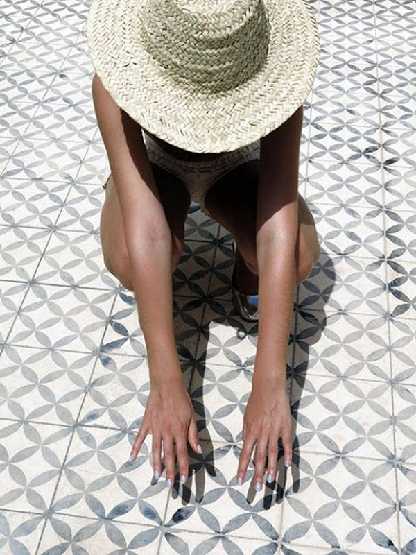 summer panama hat tile floor sun