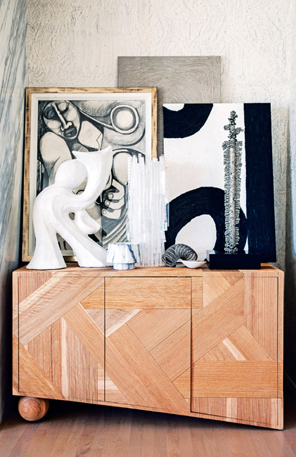 Kelly Wearstler Malibu home Vogue Living photo by Nick Hudson vignette black white paintings wood console