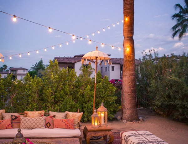 summer Moroccan dinner party inspo Korakia Palm Springs seating string lights via 1000 Layer Cake