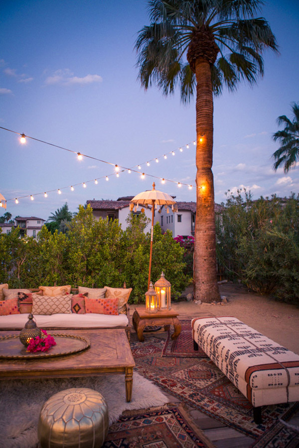 summer Moroccan dinner party inspo Korakia Palm Springs seating string lights via 100 Layer Cake