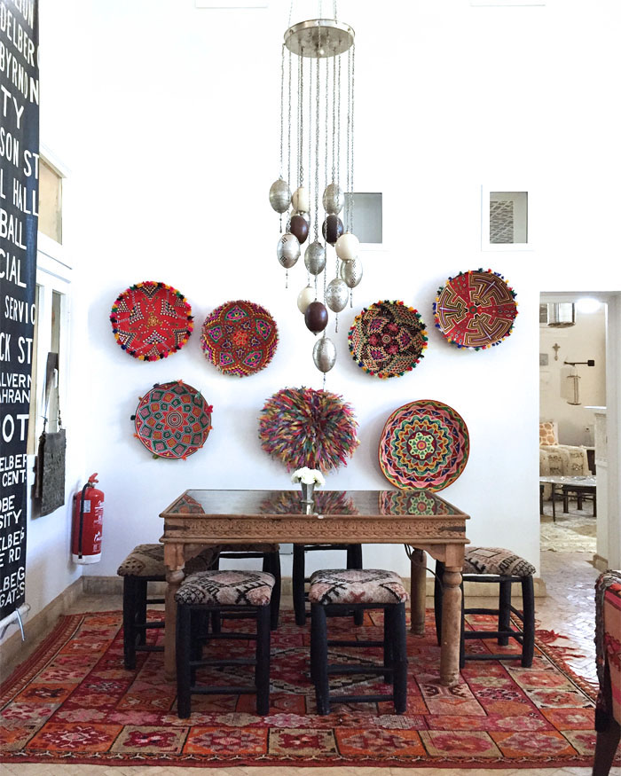 Morocco Marrakech Peacock Pavilions Maryam Montague dining table hanging baskets Erika Brechtel