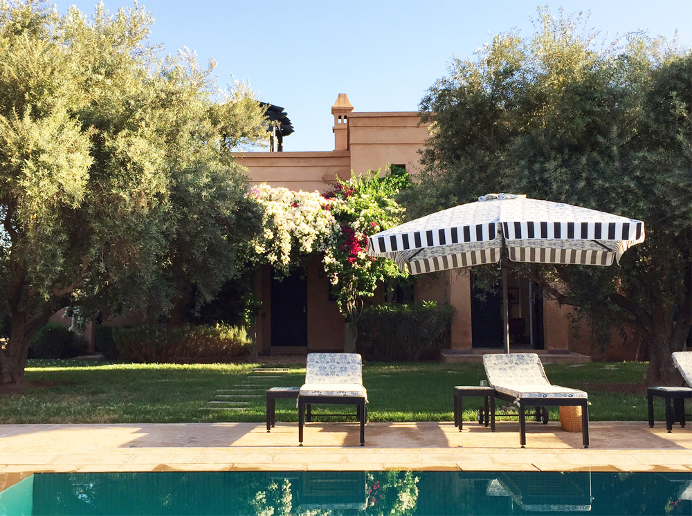Morocco Marrakech Peacock Pavilions Maryam Montague pool striped umbrella Erika Brechtel